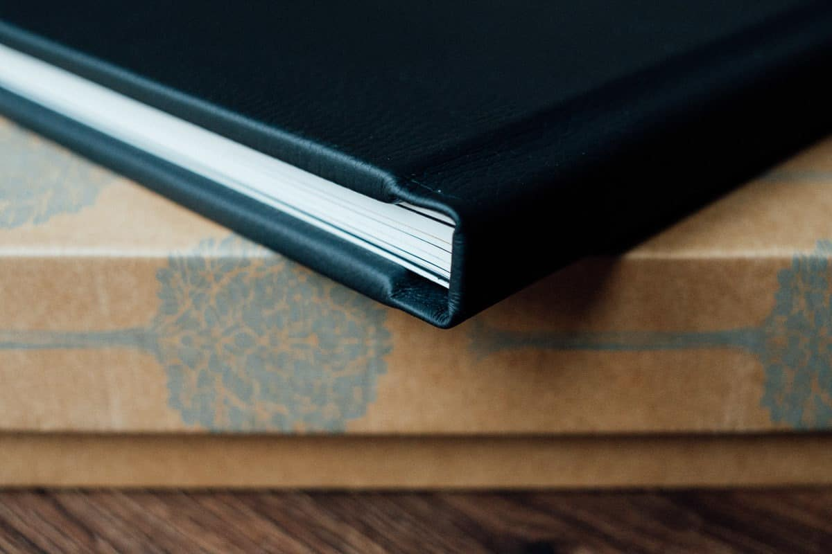 fine art wedding albums featuring black leather cover