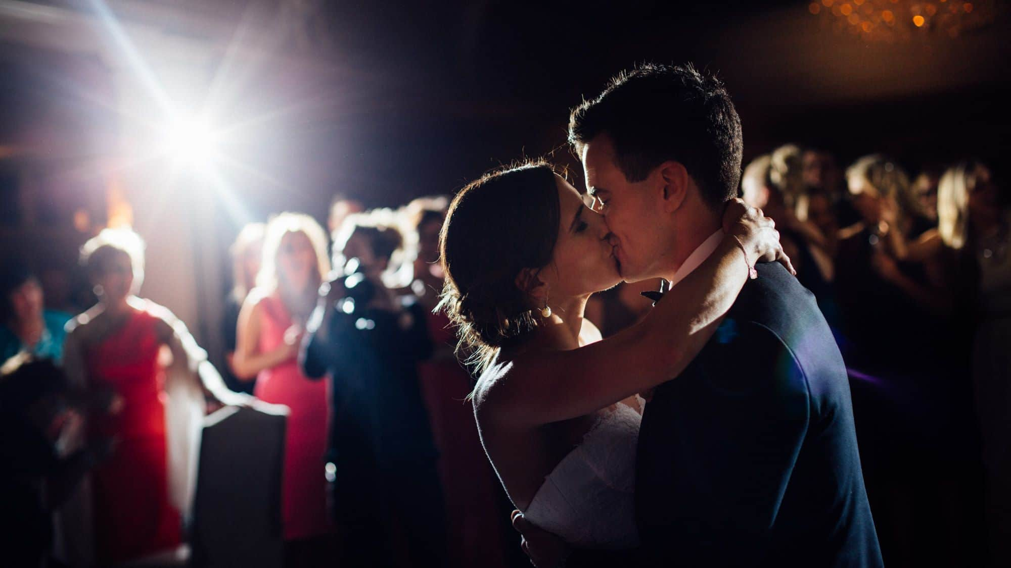 Bride and groom kiss on the dancefloor at Tankardstown House
