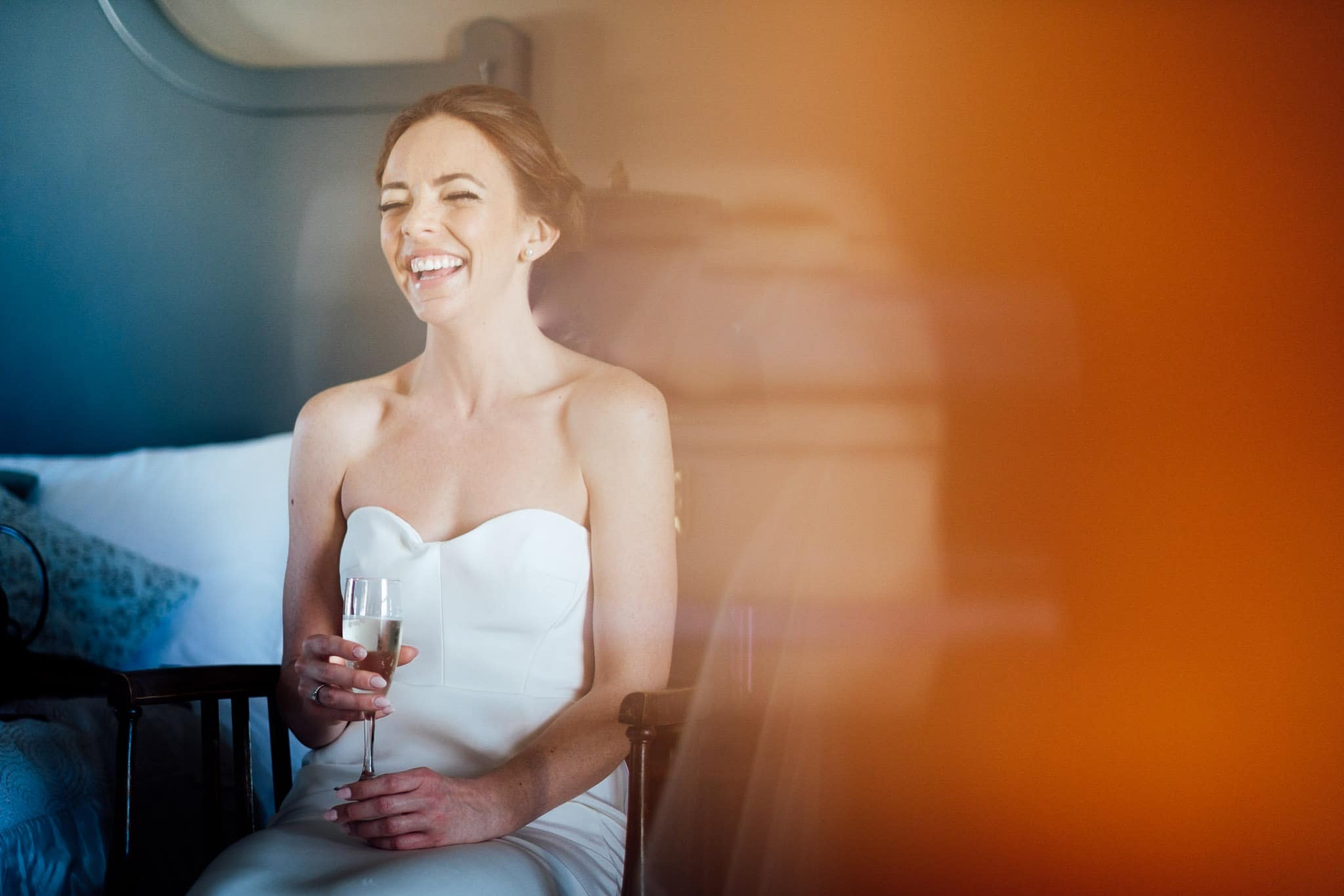 bride laughing on the morning of her wedding