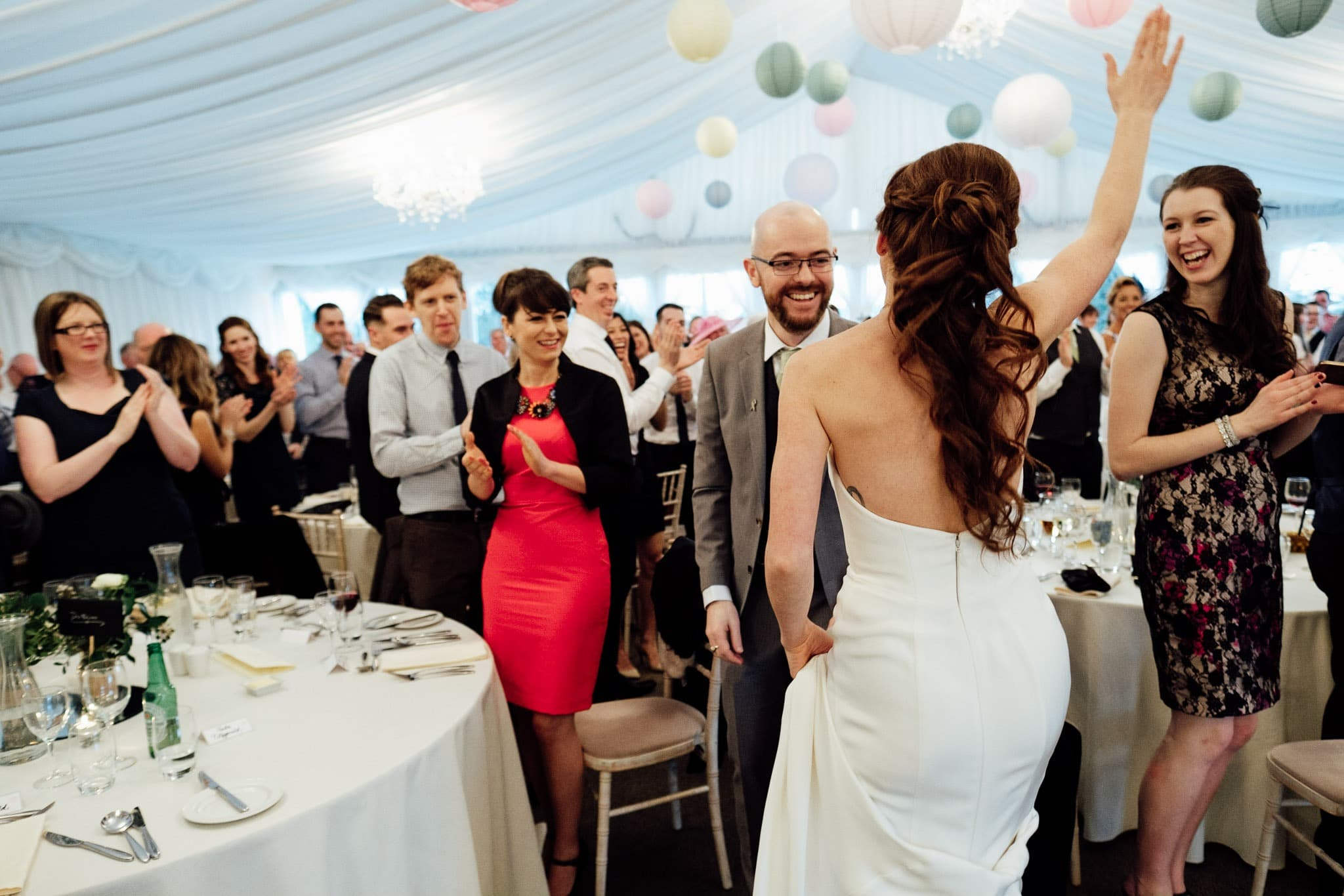 the bride and groom dancing in front of their guests