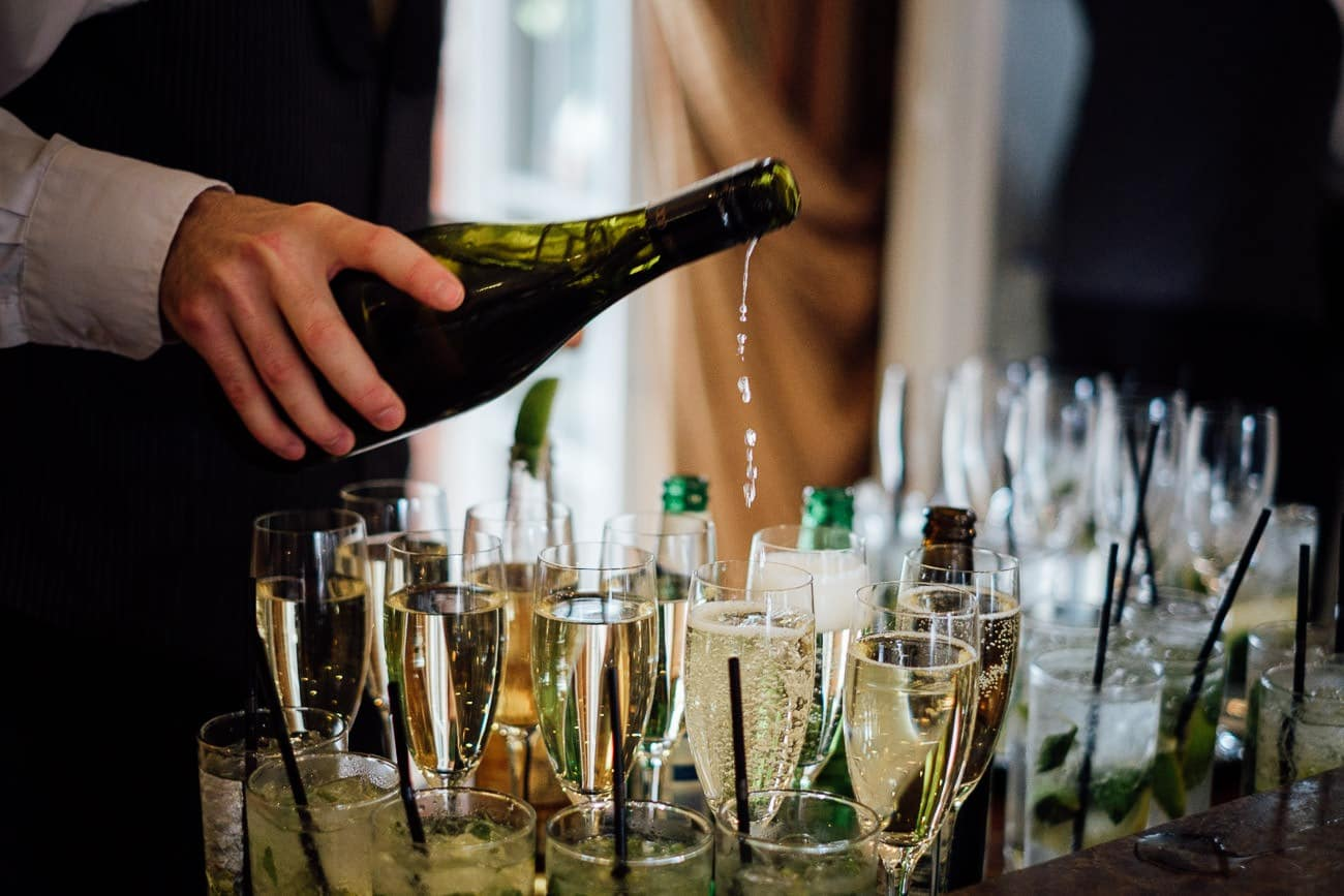 Champagne is poured at a Ballymagarvey Village wedding