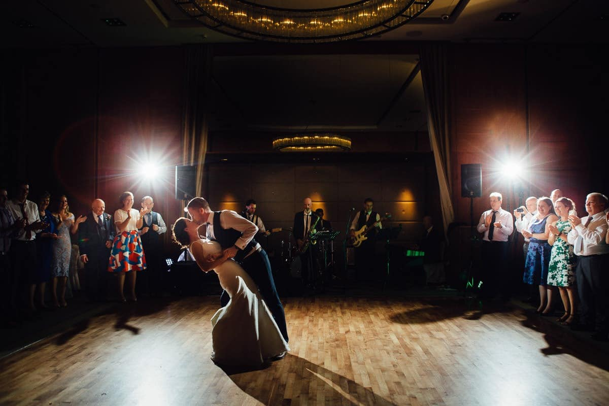 The bride and groom share a kiss on the dancefloor on their wedding day at Farnham Estate