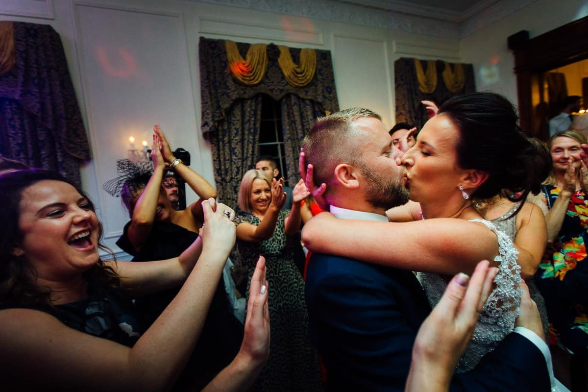 The bride and groom kiss on the dancefloor on their wedding day at Leixlip manor