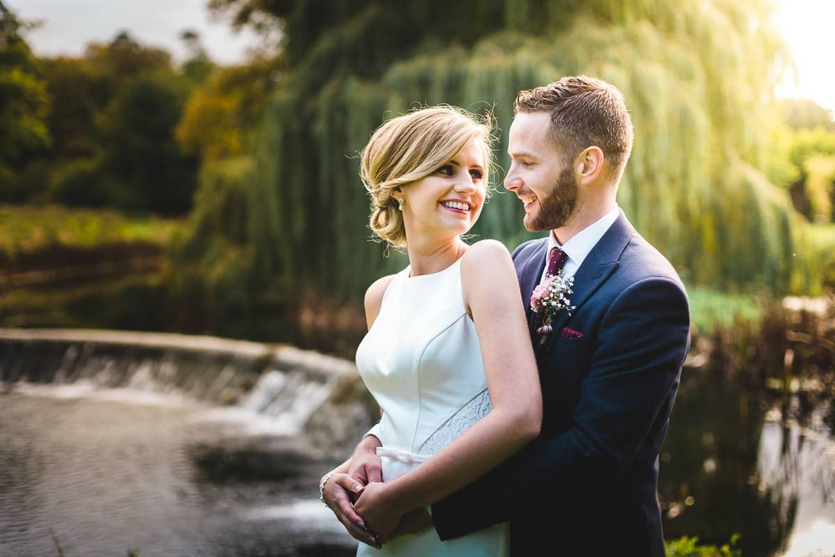 Bride and groom pose for a photo at bellingham castle on their wedding day