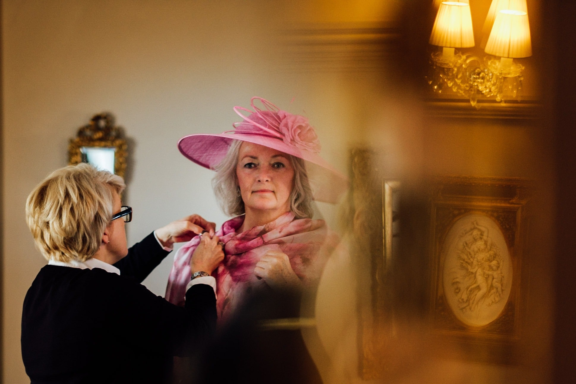 mother of the bride has her outfit adjusted at a clonabreany house wedding