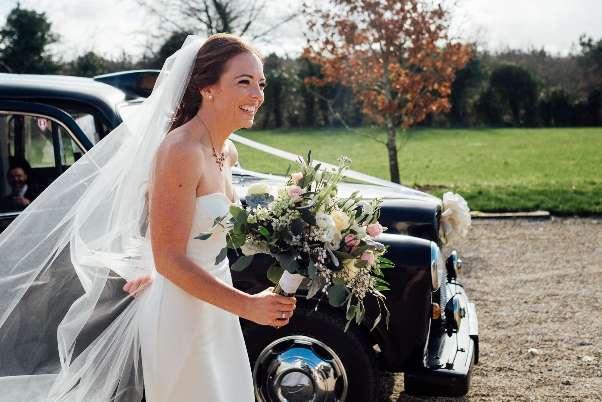 bride with bouquet walks to the ceremony room at Clonabreany house