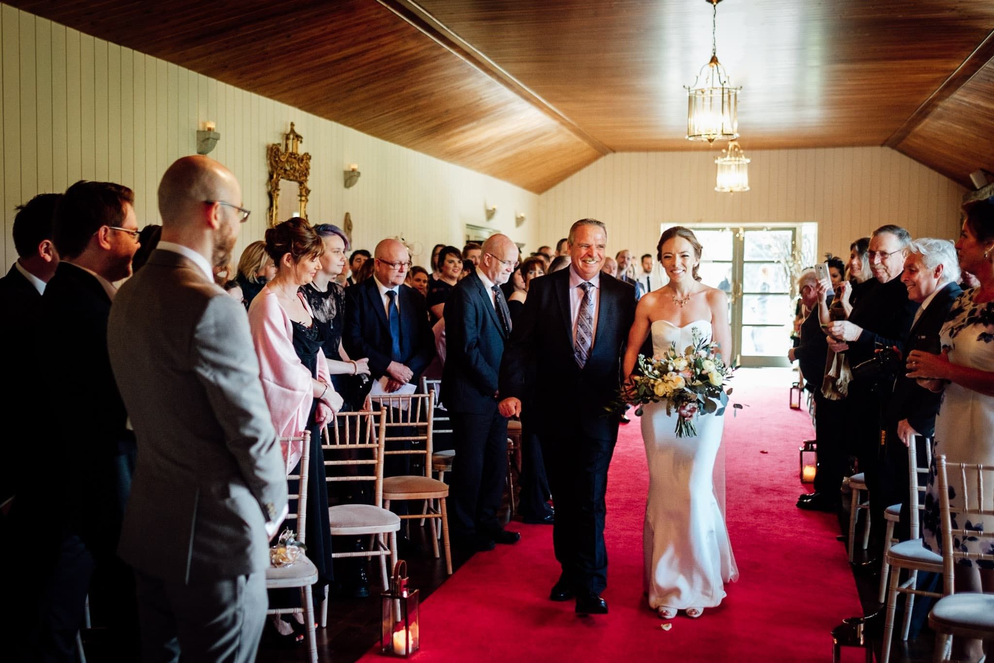 bride walks down the aisle with her father at a Clonabreany house wedding