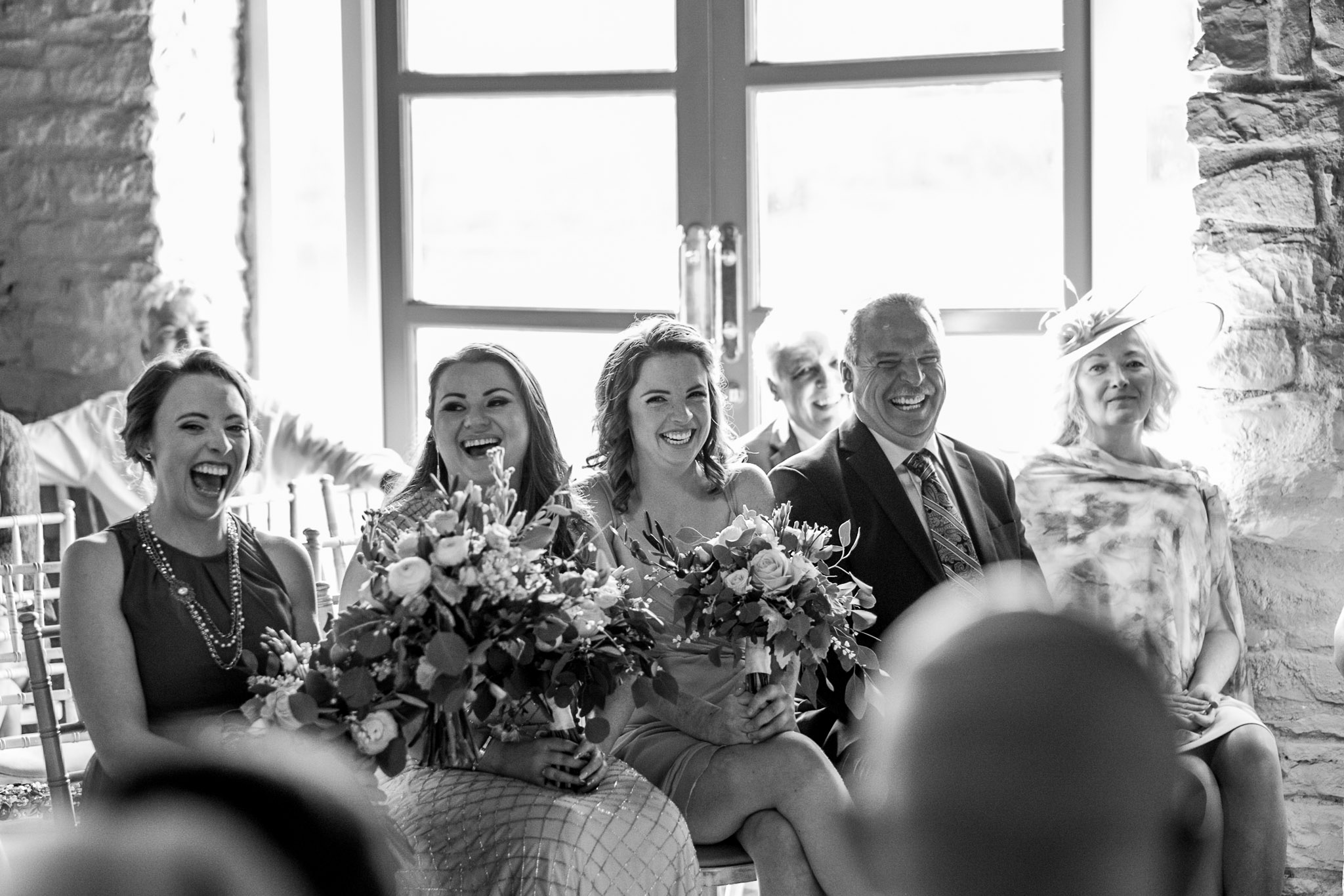guests laughing at the wedding ceremony