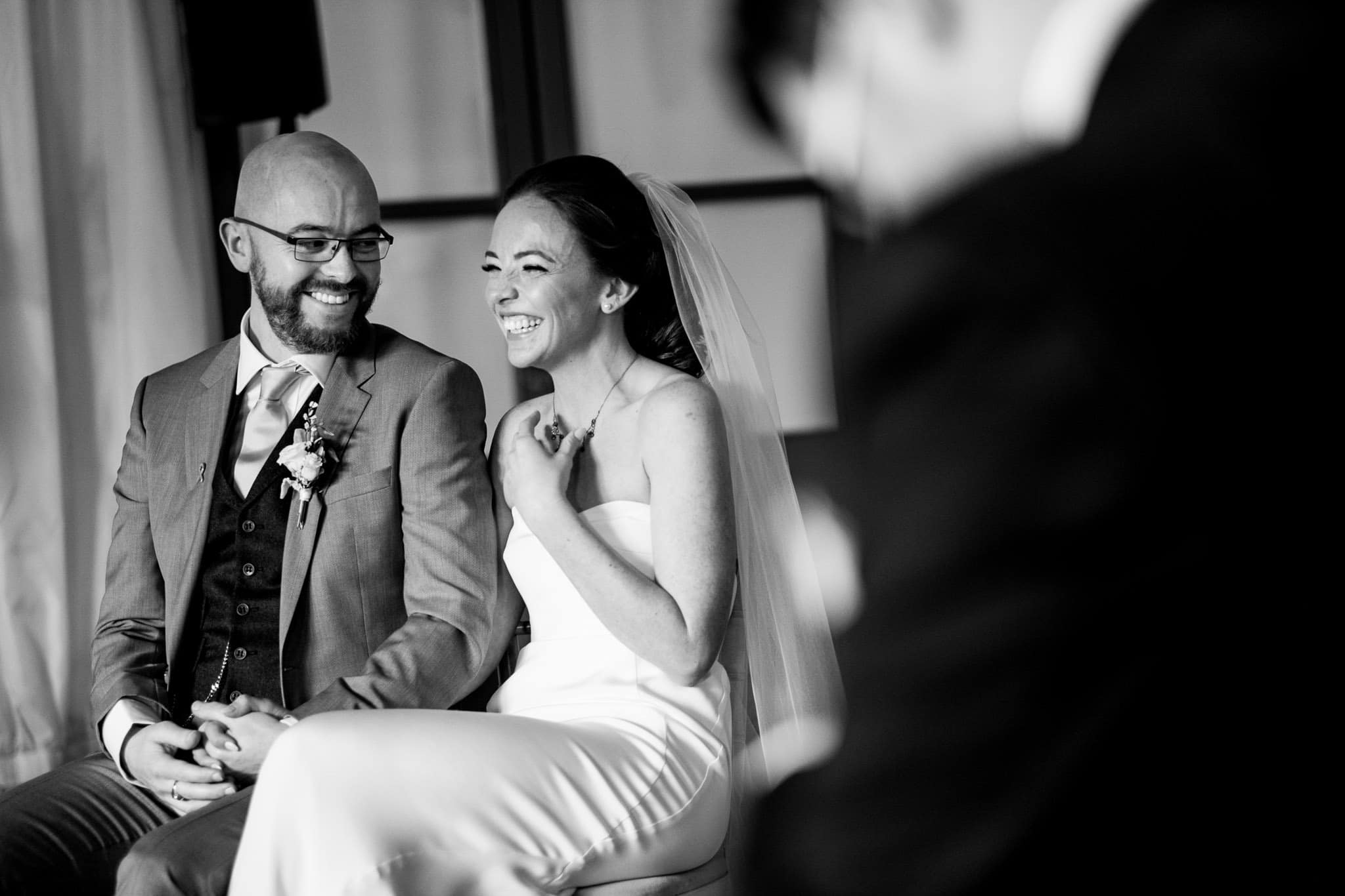 bride and groom smiling during the ceremony