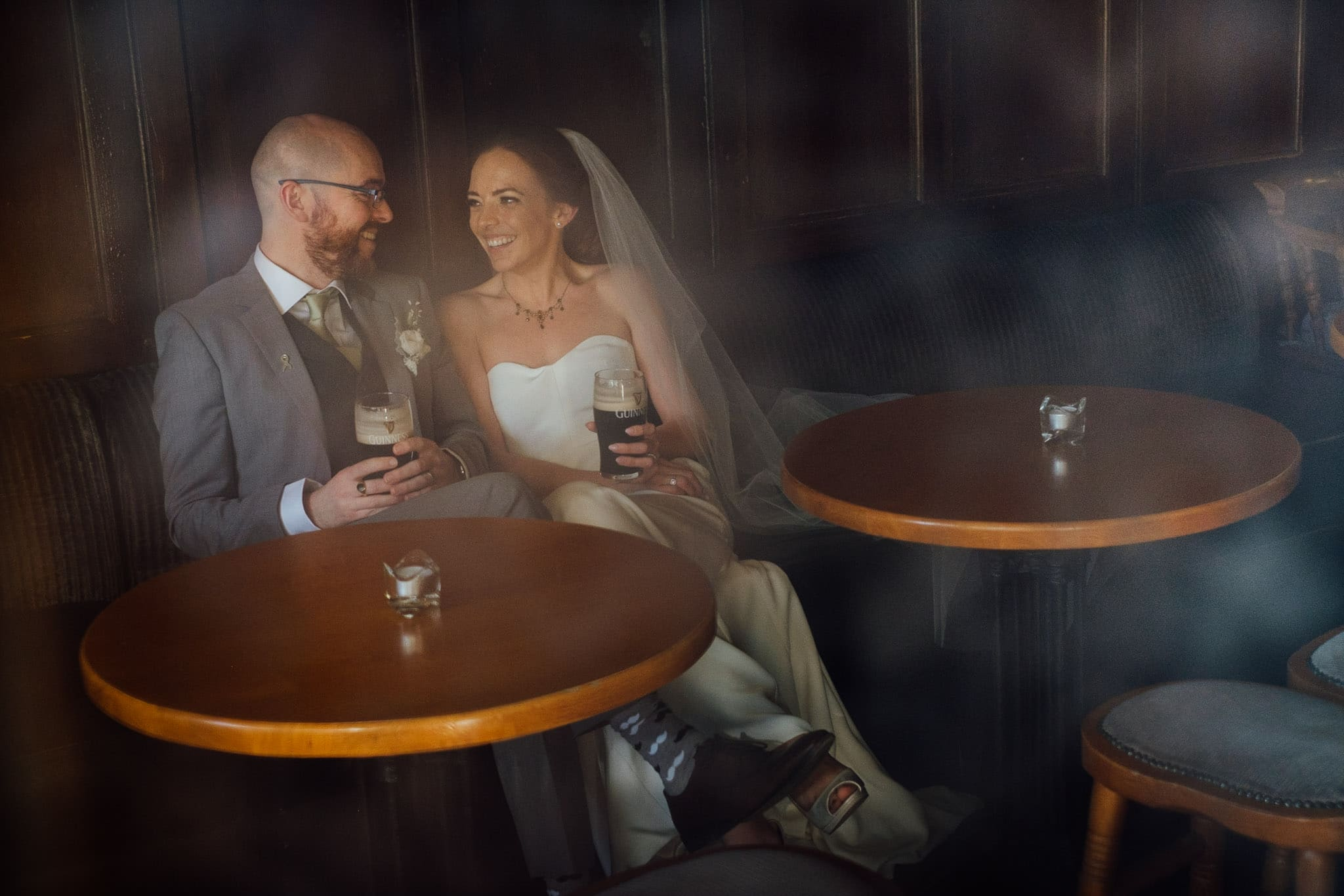 bride and groom drink a pint of guinness