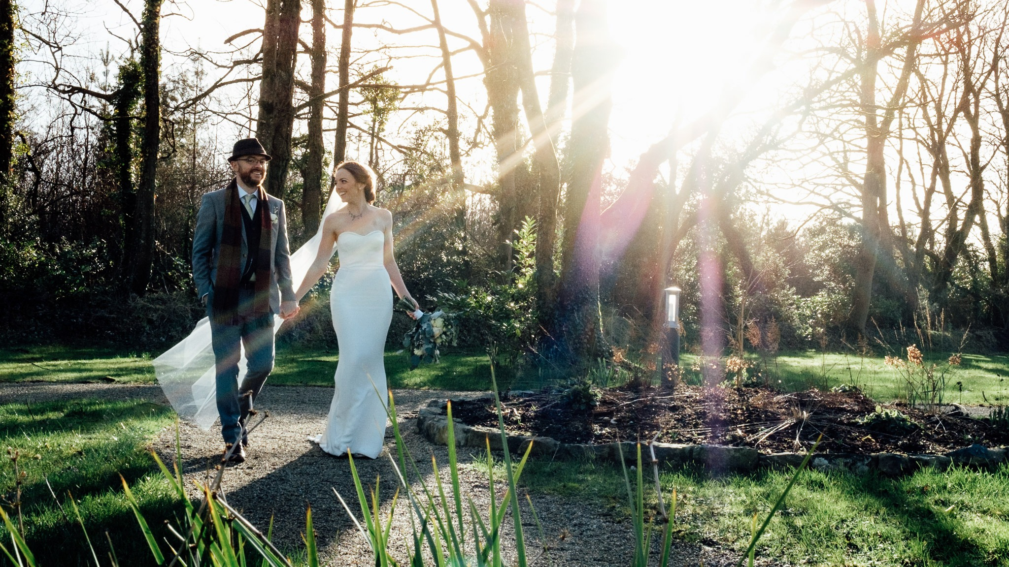 bride and groom walking around the grounds of clonabreany house