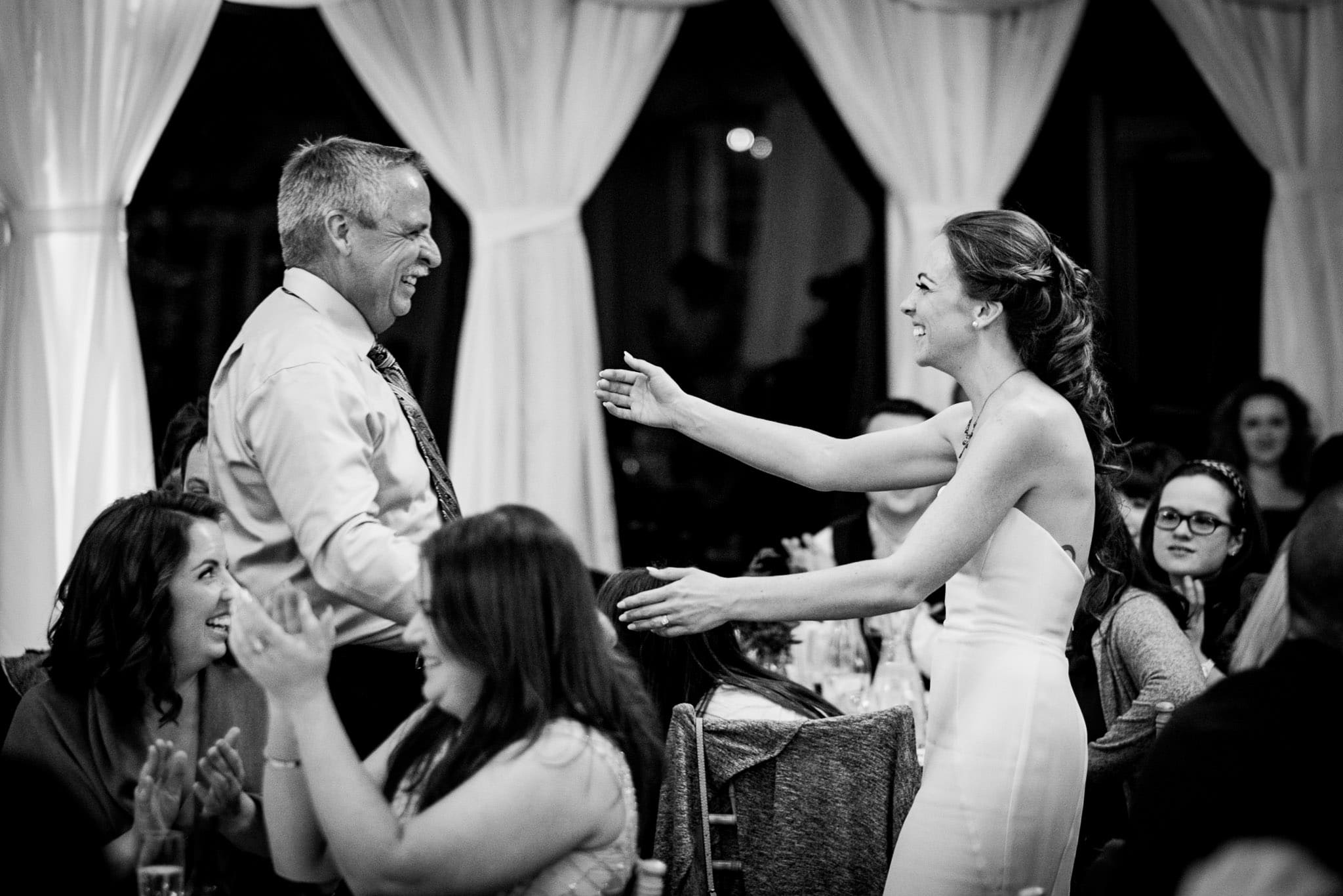 bride about to hug her father