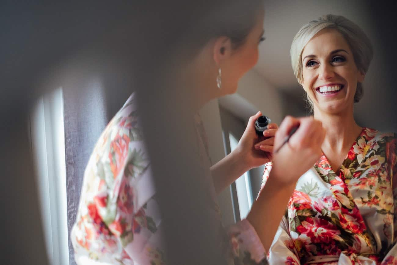 the bride laughing with her make up artist
