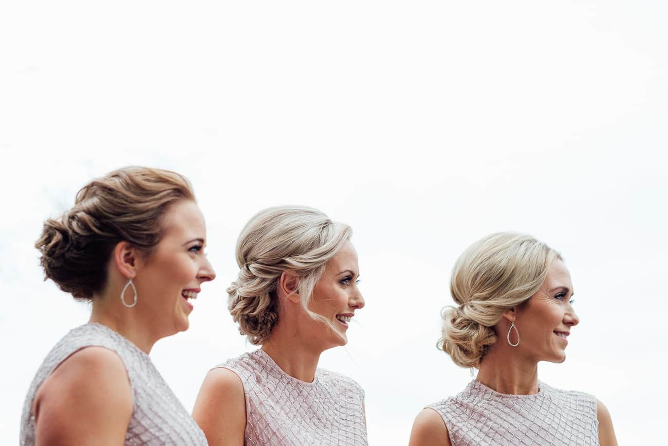 the bridesmaids smiling while waiting for the bride to arrrive