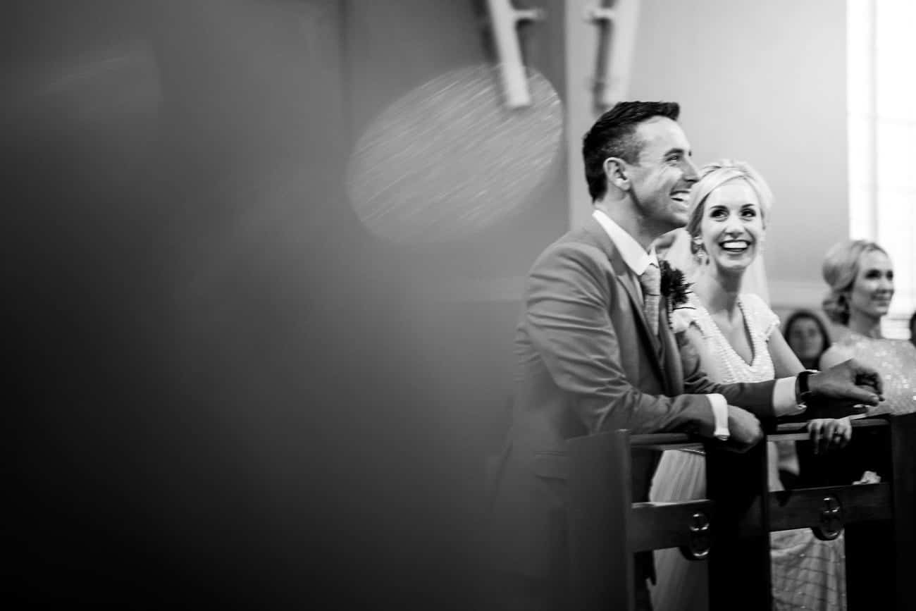 The bride and groom laughing during the ceremony