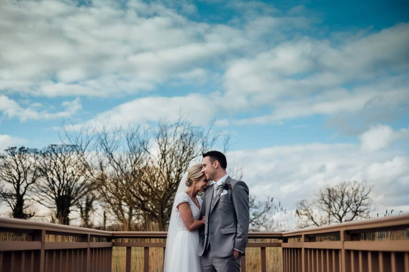 the bride and groom laugh together at ballymagarvey village
