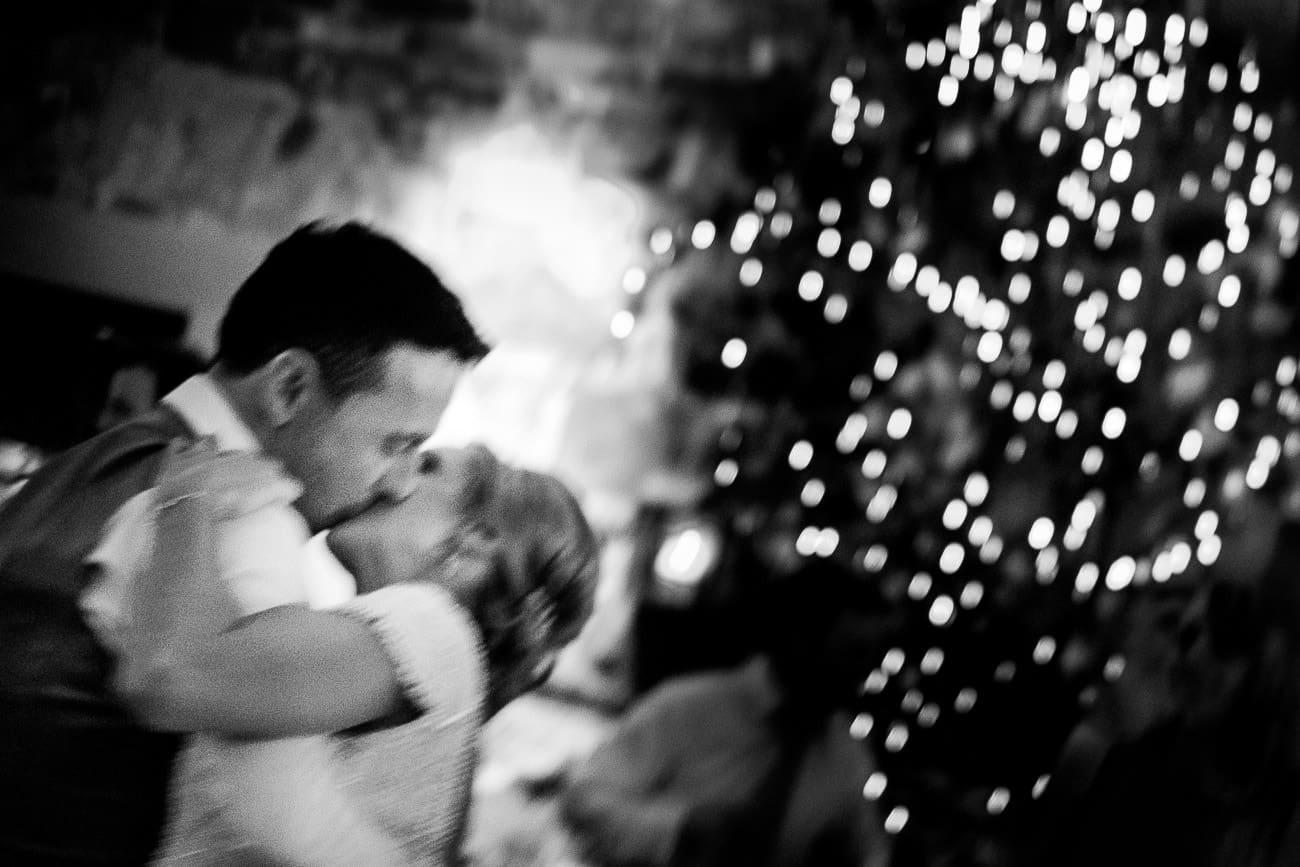 The bride and groom kiss on the dancefloor